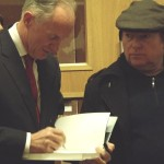 Linenhall Librarian John Killen giving his autograph to Van Morrison!